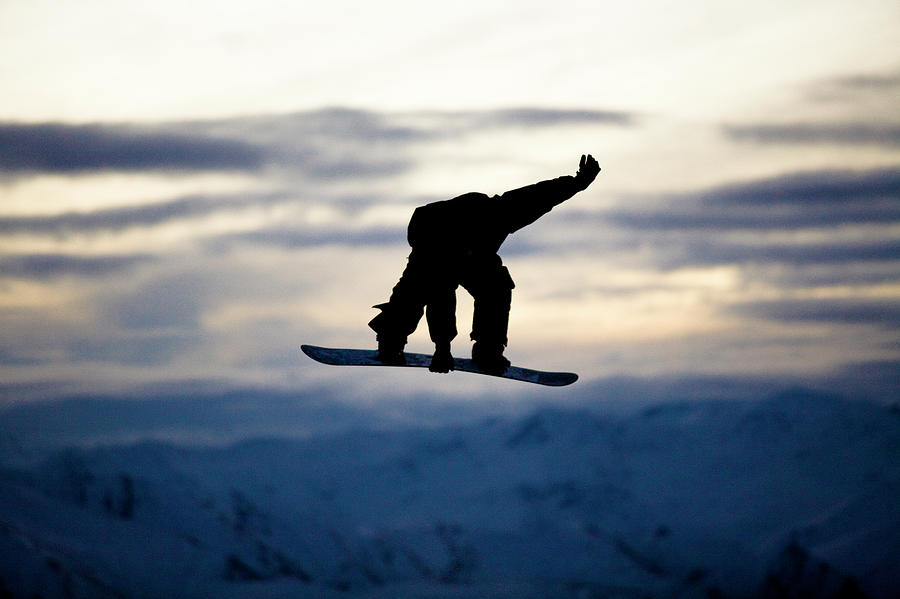 A Male Snowboarder Does A Backside 180 Photograph by Kyle Sparks