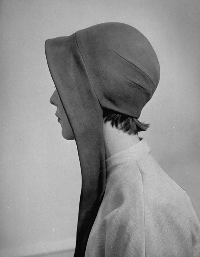 A Model Posing In A Bonnet Styled Hat Wi Photograph by Nina Leen