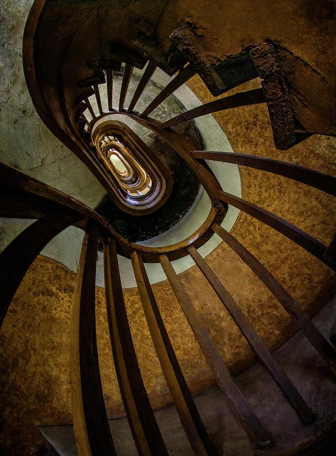 Abandoned spiral staircase by Jaroslaw Blaminsky