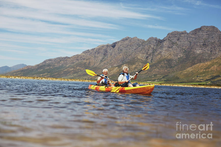 Active Seniors Photograph - Active Senior Couple Kayaking On Sunny Summer Lake by Caia Image/science Photo Library