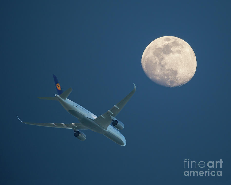 Airliner and Full Moon by Kevin McCarthy
