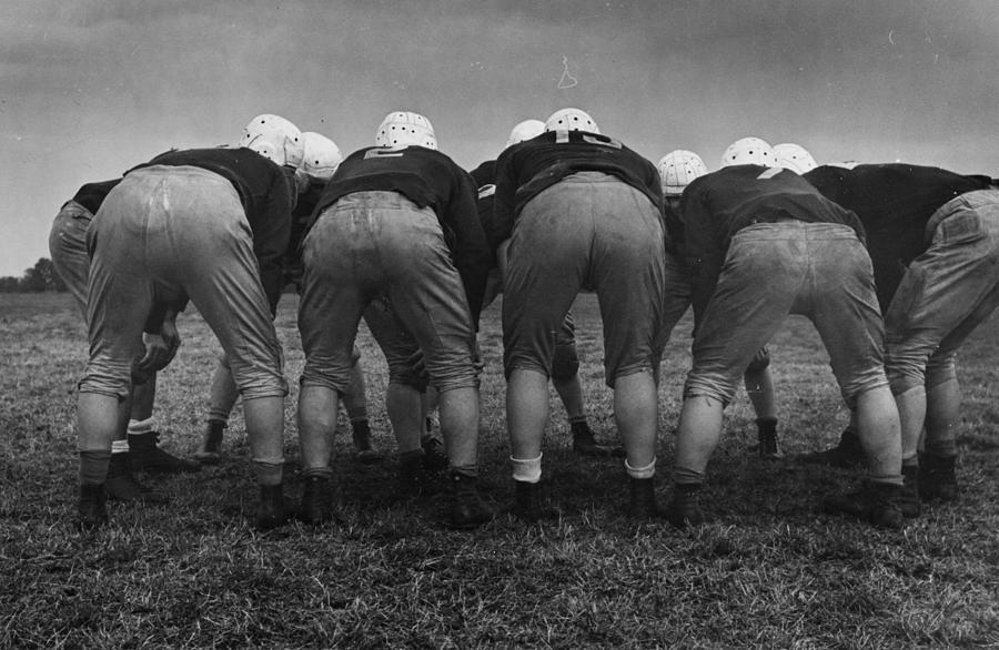 American Huddle Photograph by Kurt Hutton