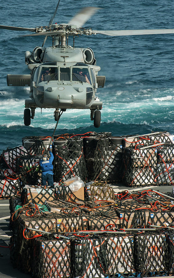 An Mh-60s Seahawk Helicopter Transports by Stocktrek Images