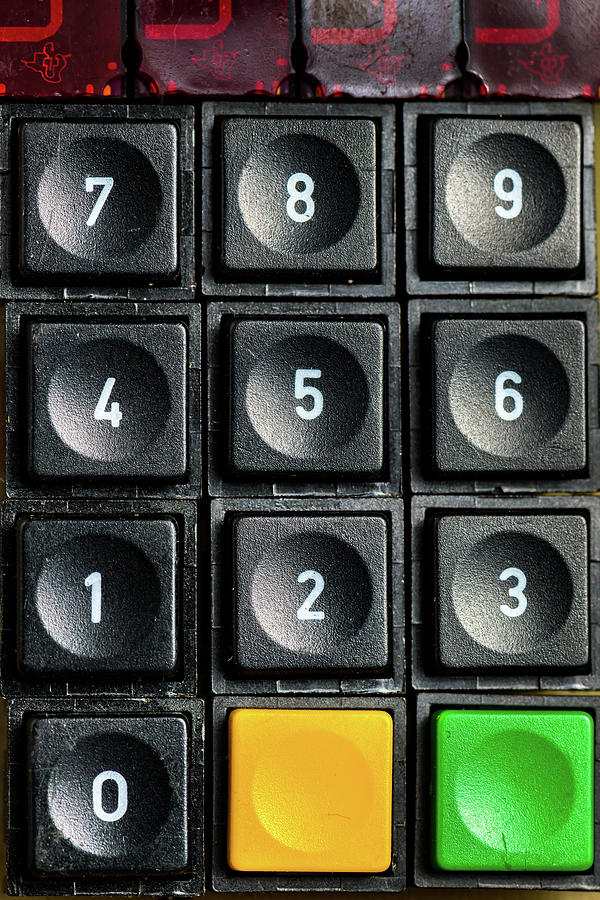 An Old Numeric Keypad With Additional Buttons Photograph
