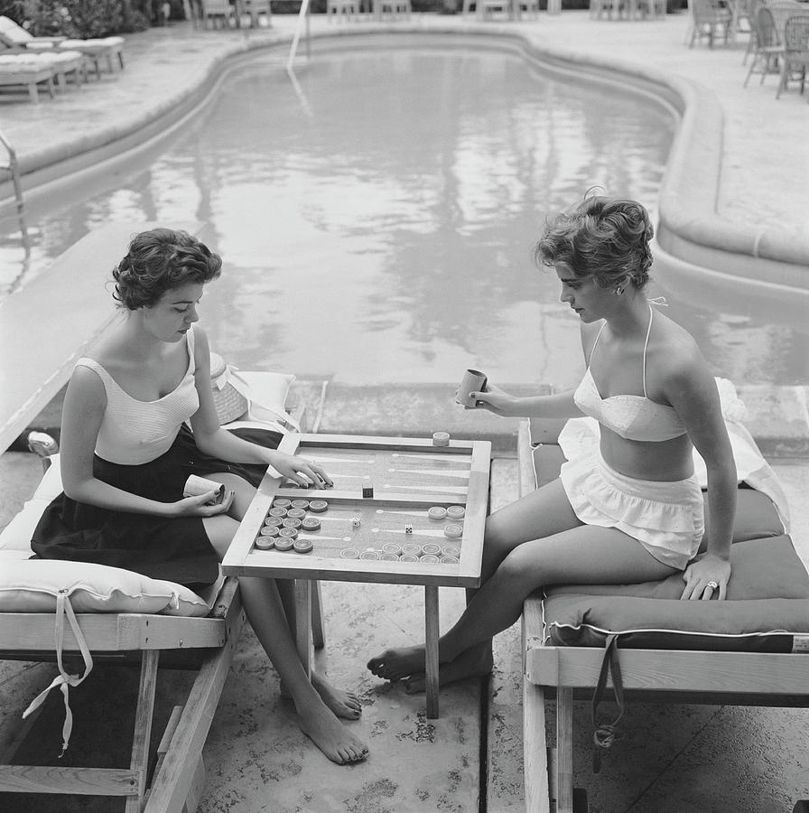 Backgammon By The Pool Photograph by Slim Aarons