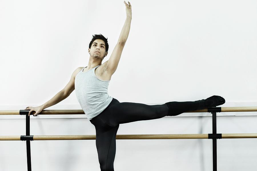 Ballet Dancer Stretching In Dance Photograph by Patrik Giardino
