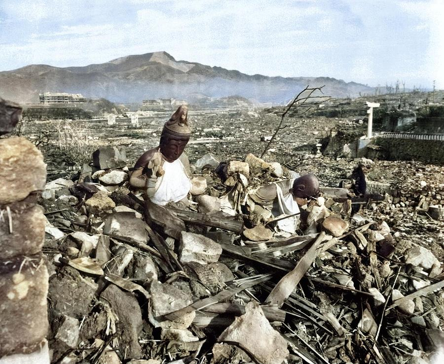 Battered religious figures stand watch on a hill above a tattered valley. Nagasaki, Japan. September by Ahmet Asar