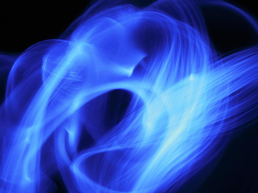 Blue Fiber Optic Light Streaks Against Photograph by Steven Puetzer