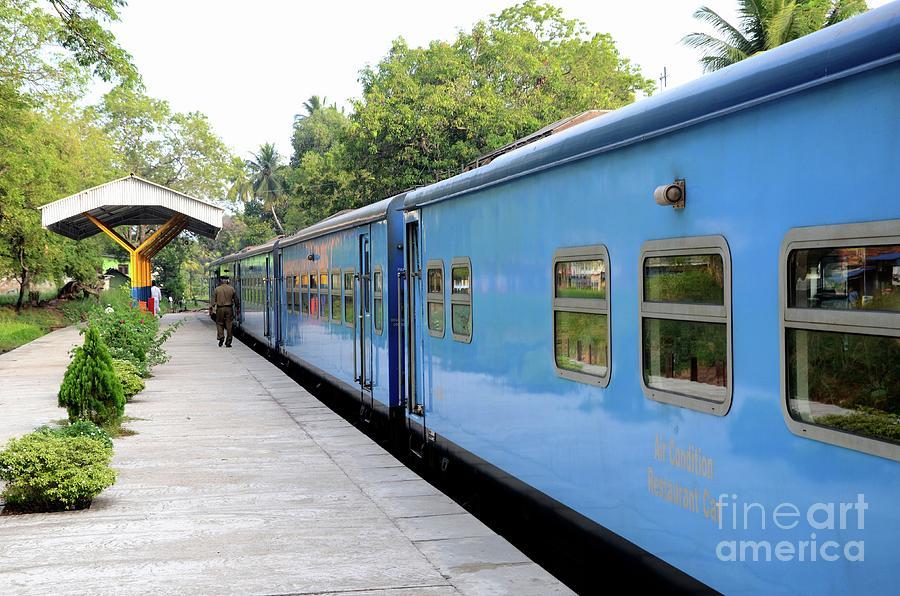 Blue Sri Lanka Colombo to Jaffna railway train parked at platform  by Imran Ahmed