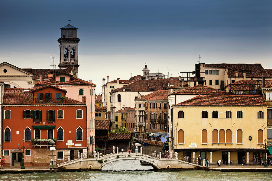 Buildings And Bridge On Urban Canal Photograph by Walter Zerla