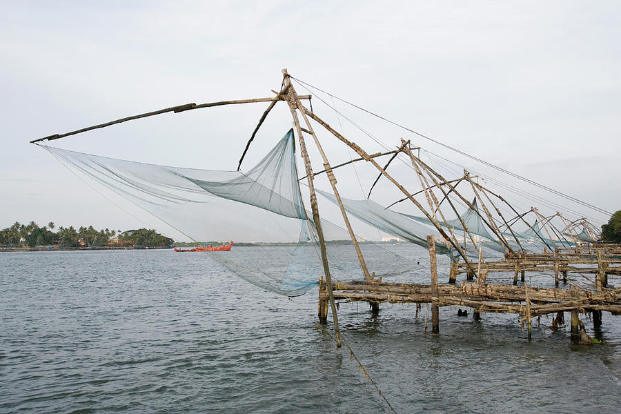 Tranquility Photograph - Chinese Fishing Nets At A Harbor by Exotica.im
