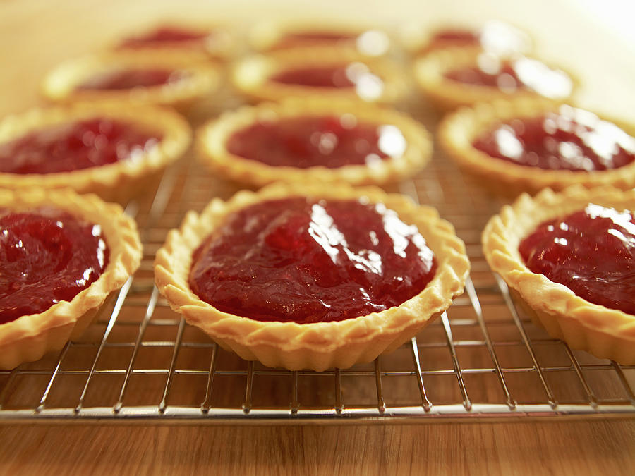 Close Up Of Jam Tarts Cooling On Wire Photograph by Adam Gault
