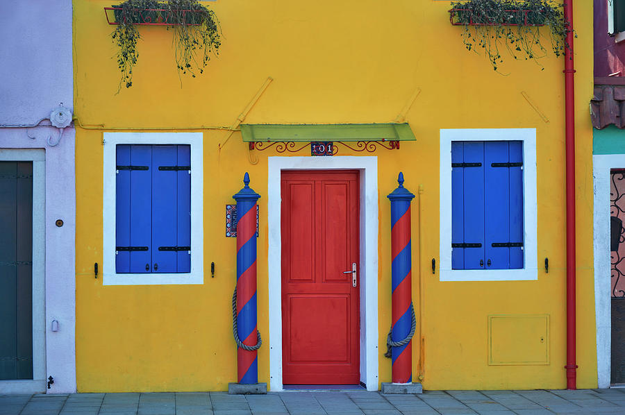 Colourfully Painted Houses On Burano Photograph by Izzet Keribar