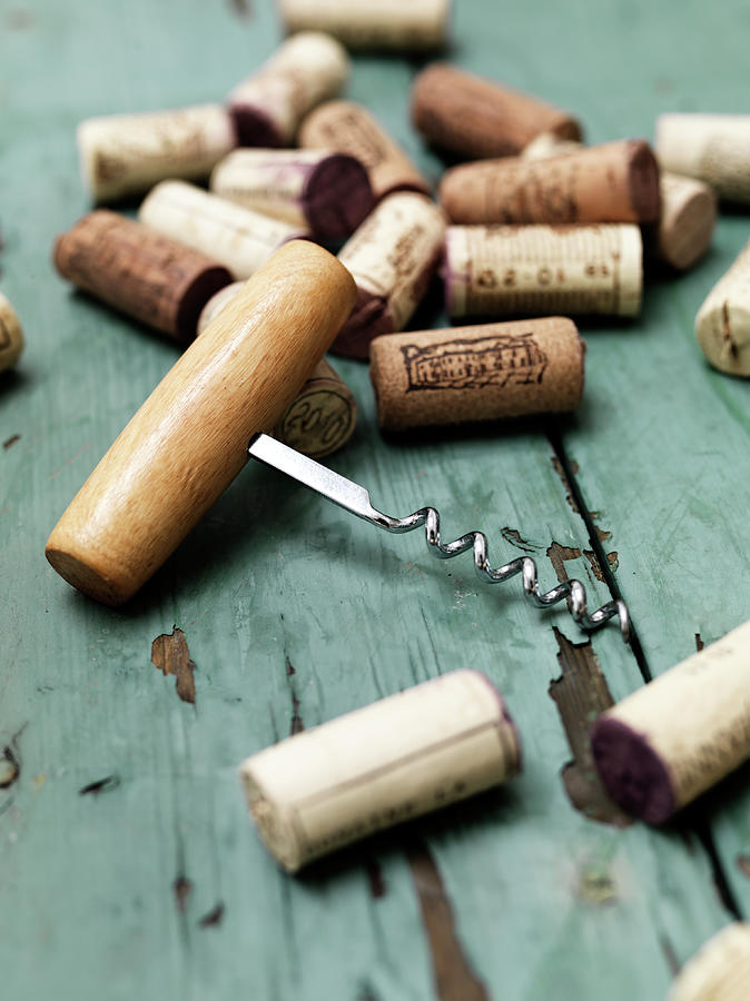 Corks With Corkscrew Photograph by Henrik Sorensen