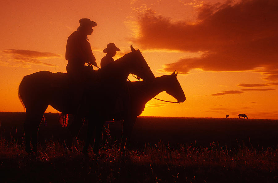Cowboys at Sunset in Montana by Carl Purcell