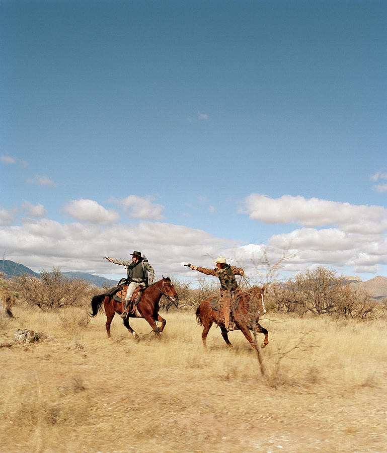 Cowboys Riding On Horses Photograph by Matthias Clamer