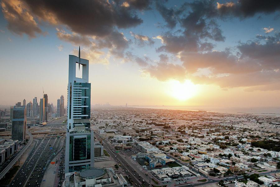 Dubai Cityscape At Sunset Photograph by Pidjoe