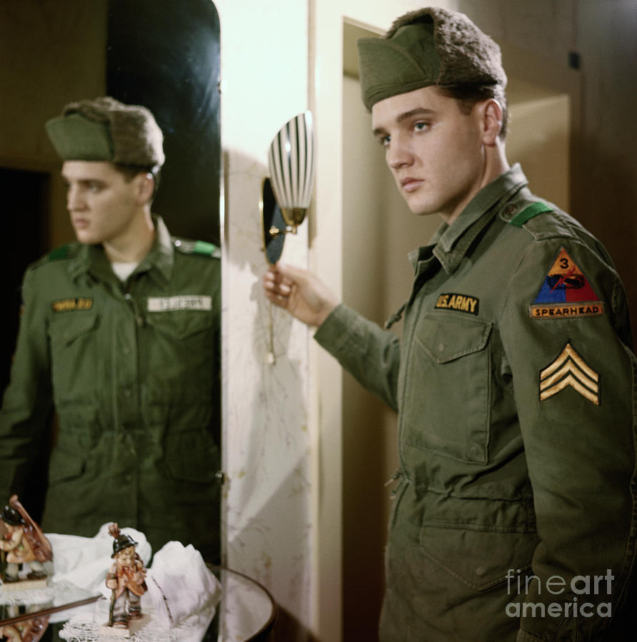 Elvis Presley Showing His Army Stripes Photograph by Bettmann