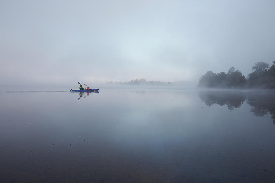Father And Son Paddling In A Canoe On A Photograph by Poncho