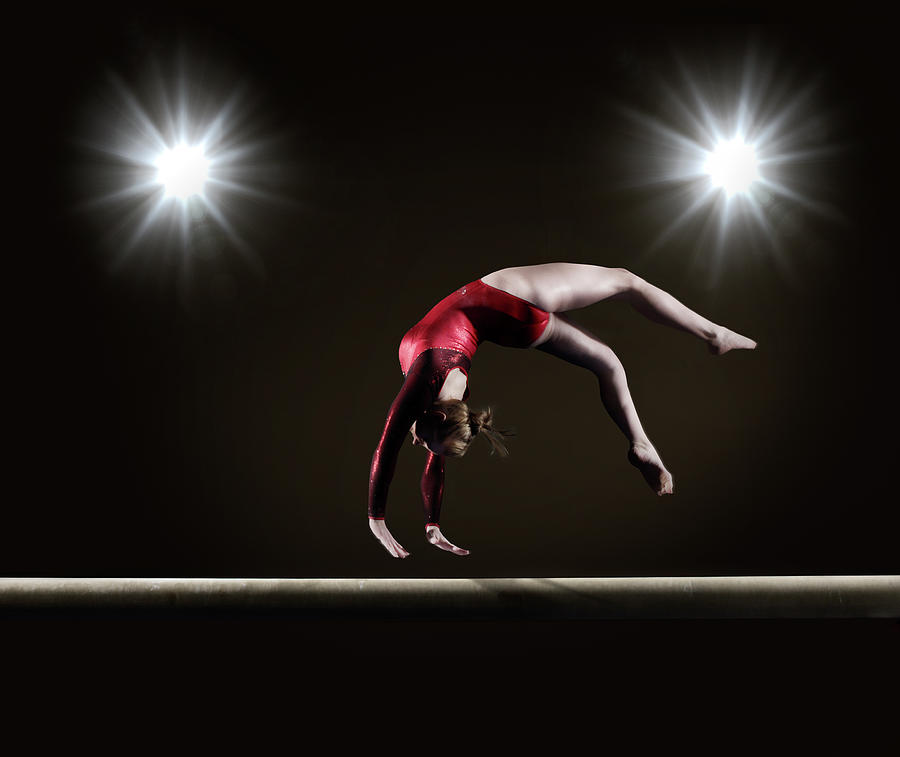 Female Gymnast On Balance Beam Photograph by Mike Harrington