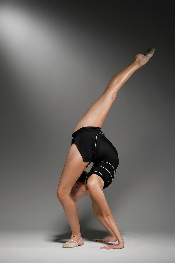 Female Gymnast Stretching, Studio Shot Photograph by Siri Stafford
