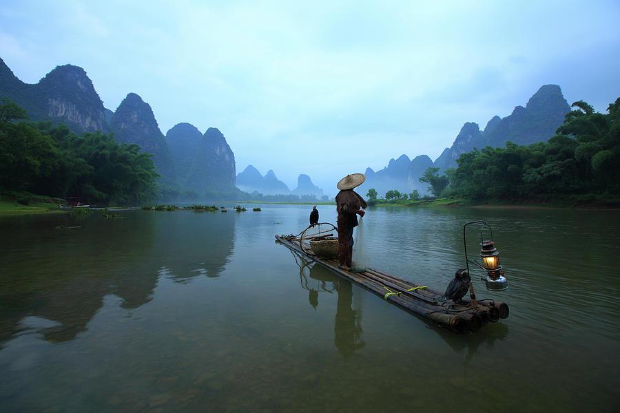 Fisherman On Li River Photograph by Bihaibo