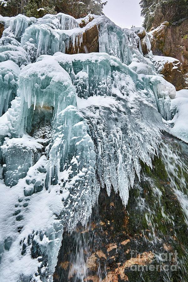 Frozen waterfall in the winter by Catalin Petolea