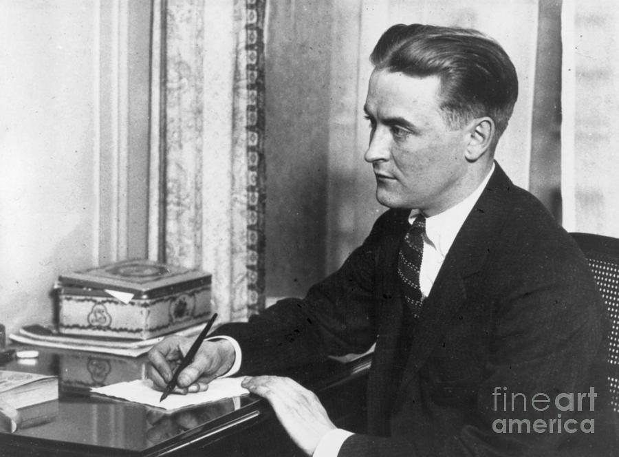 F.scott Fitzgerald Writing At Desk Photograph by Bettmann