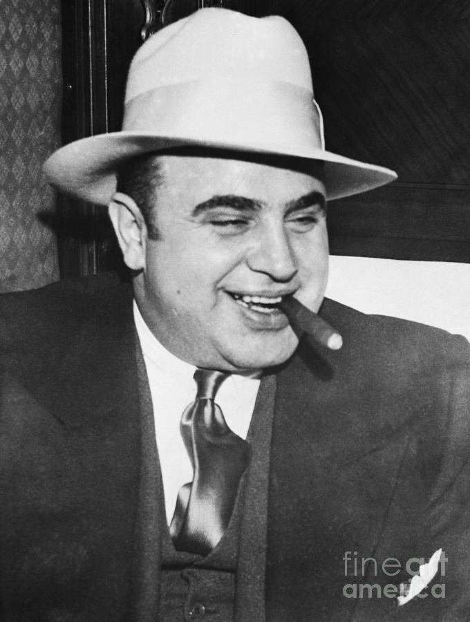 Gangster Al Capone Smoking Cigar Photograph by Bettmann