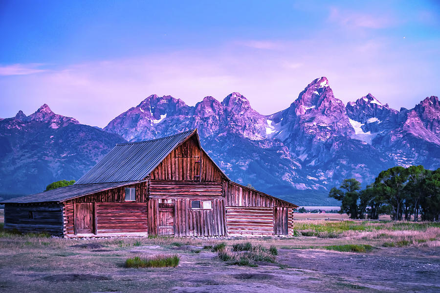 Grand Teton scenic view with abandoned barn on Mormon Row by ALEX GRICHENKO