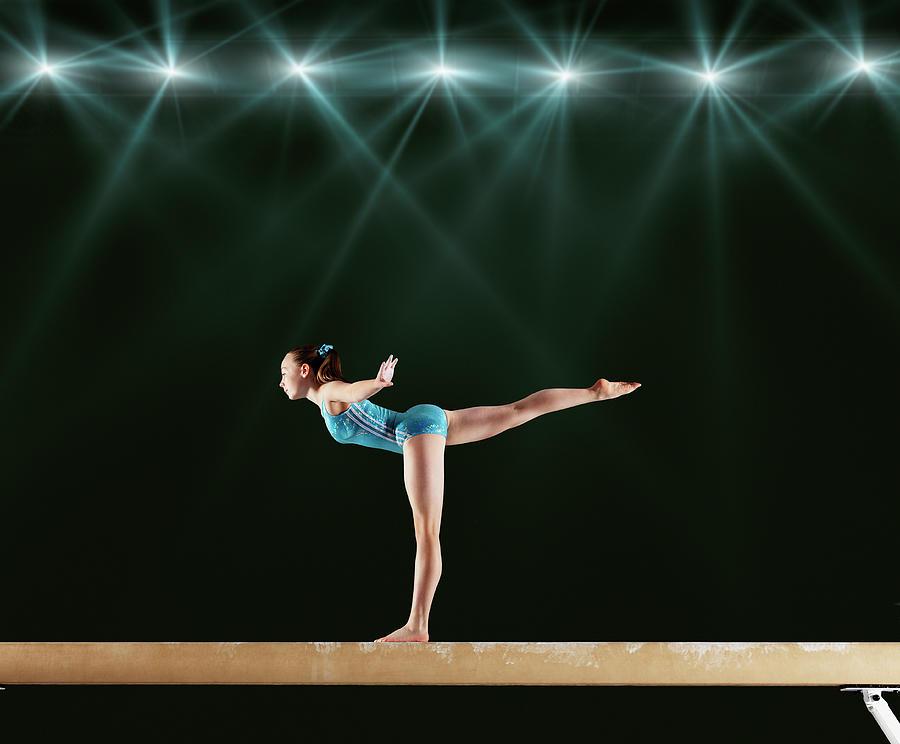 Gymnast Performing Routine On Balance Photograph by Robert Decelis Ltd