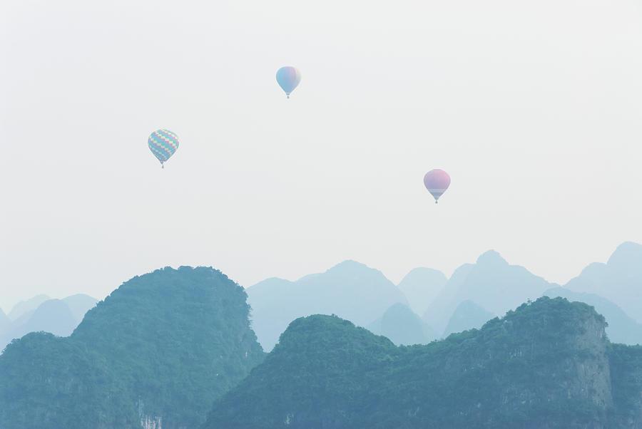 Hot Air Balloon Ride At Dawn Over Karst Photograph by Alex Linghorn