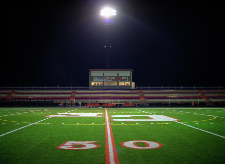 Illuminated American Football Field At Photograph by Darrin Klimek