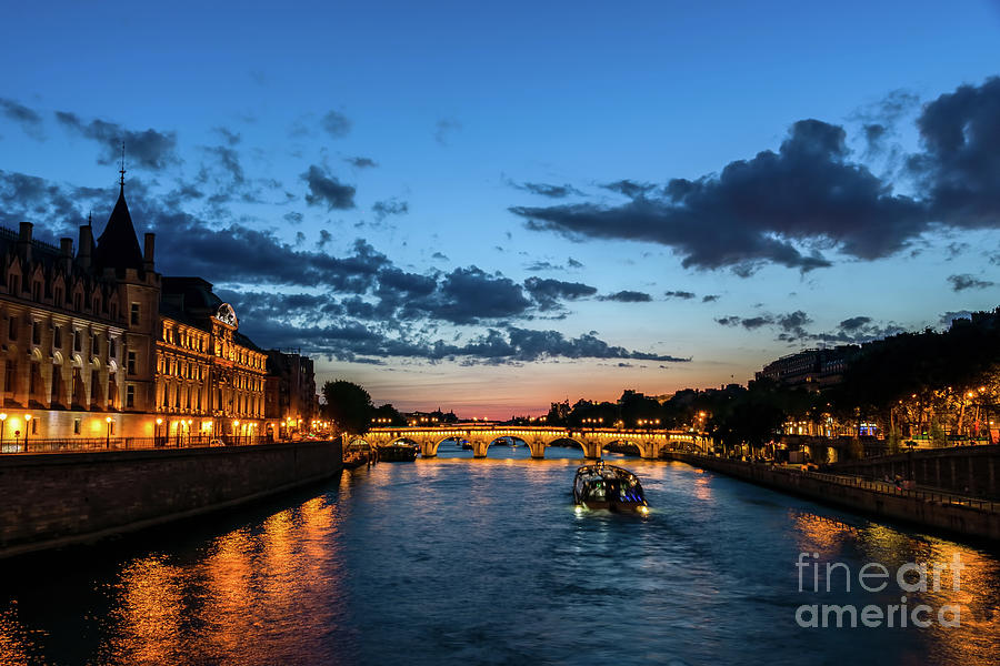 Illuminated Conciergerie at night, Paris, France. by Ulysse Pixel