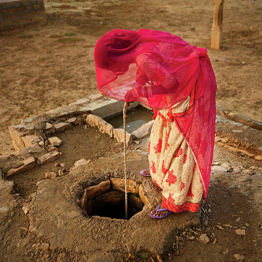 Indian Woman Getting Water From The Photograph by Hadynyah