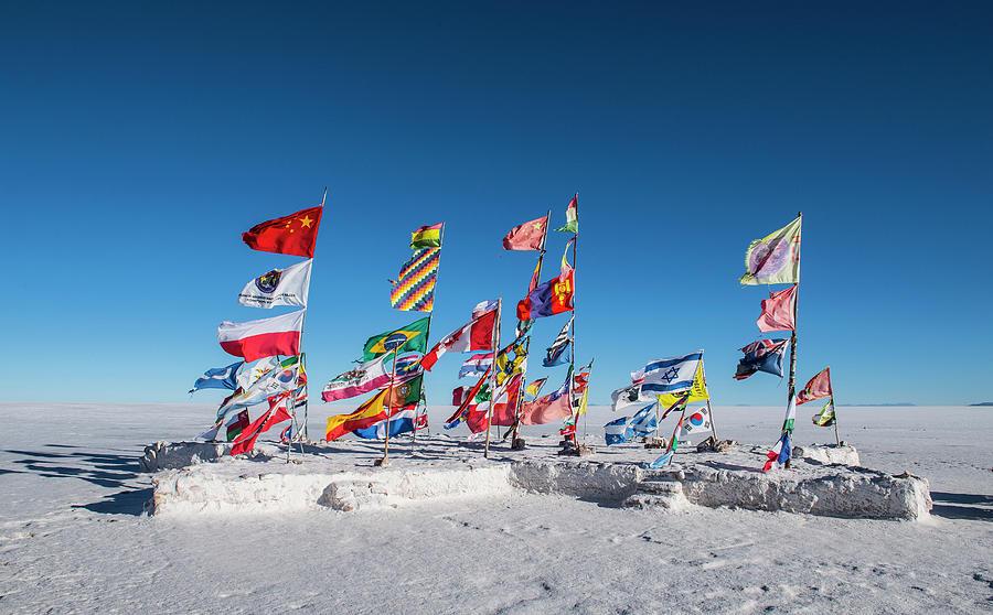 Uyuni Photograph - International Flags Planted On The Salt Flats Of Uyuni In Bolivia by Cavan Images
