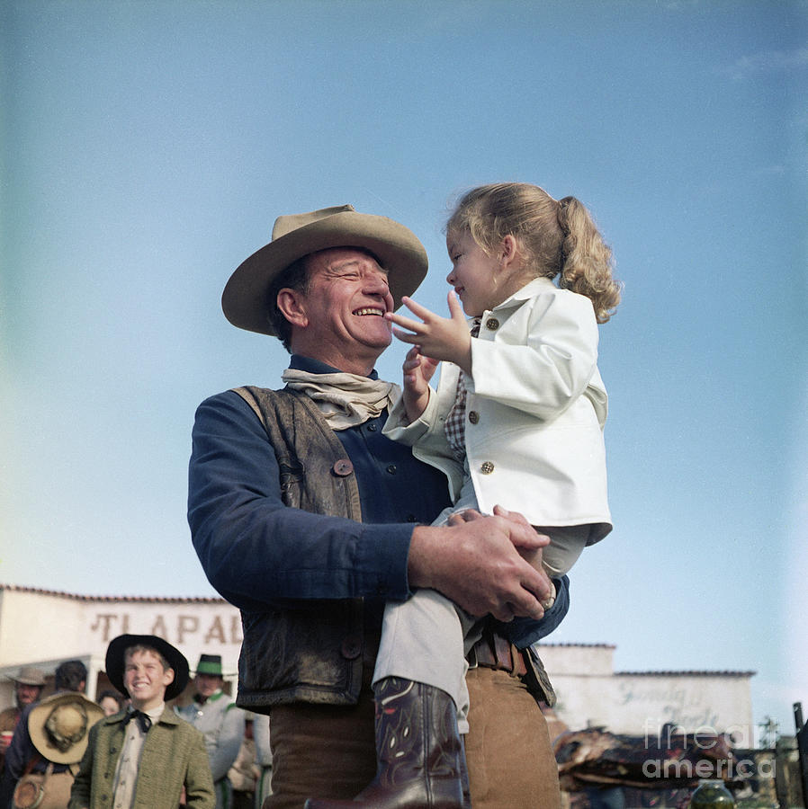 John Wayne And Daughter Aissa On Movie Photograph by Bettmann