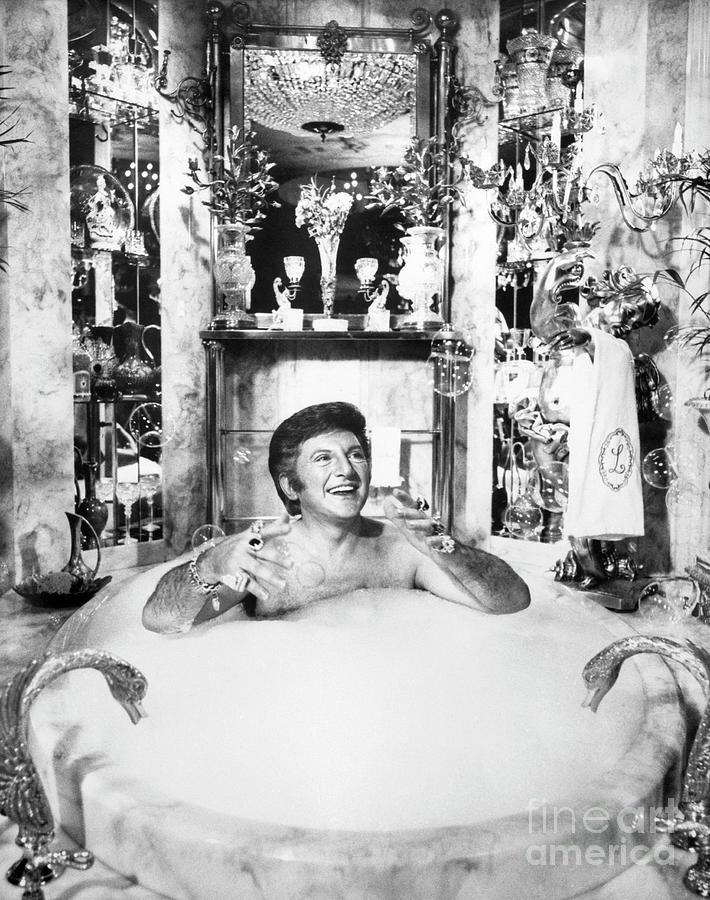 Liberace Taking A Bubble Bath Photograph by Bettmann