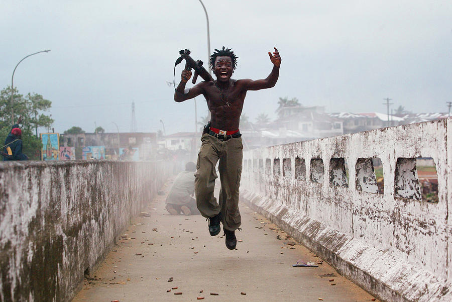 Liberian Government Troops Push Back Photograph by Chris Hondros