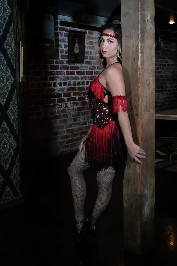 Mandy posing on wood post in 1920 outfit by Dan Friend