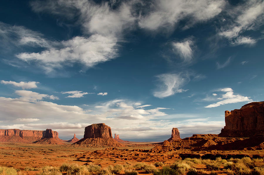 Monument Valley With Dramatic Clouds Photograph by Russell Burden