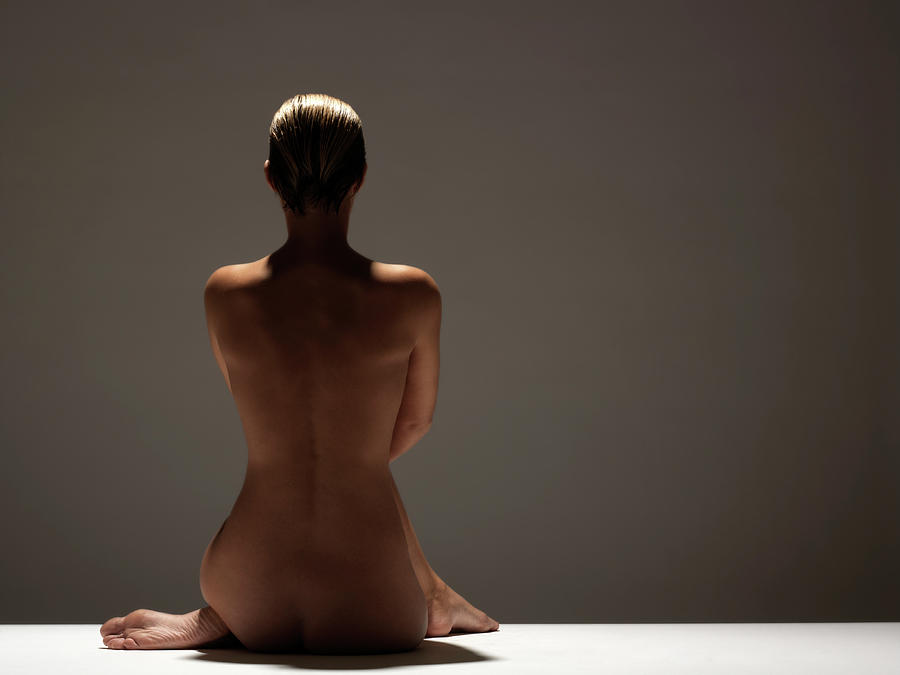 Naked Woman Sitting, Rear View Photograph by John Lamb