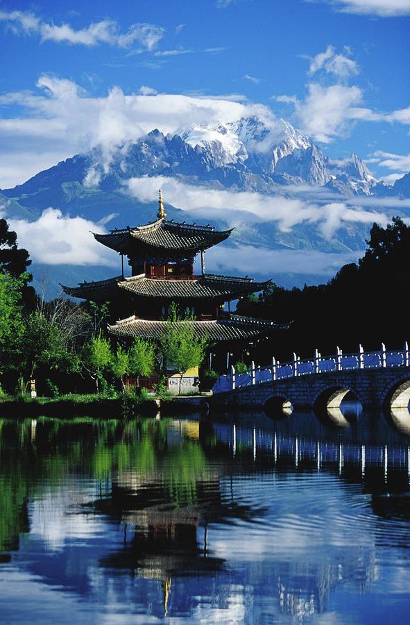 Pagoda Reflected In Black Dragon Pool Photograph by Richard Ianson
