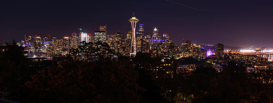 Panoramic Night View Of The Seattle Skyline With The Space Needle And Other Iconic Buildings In The Photograph