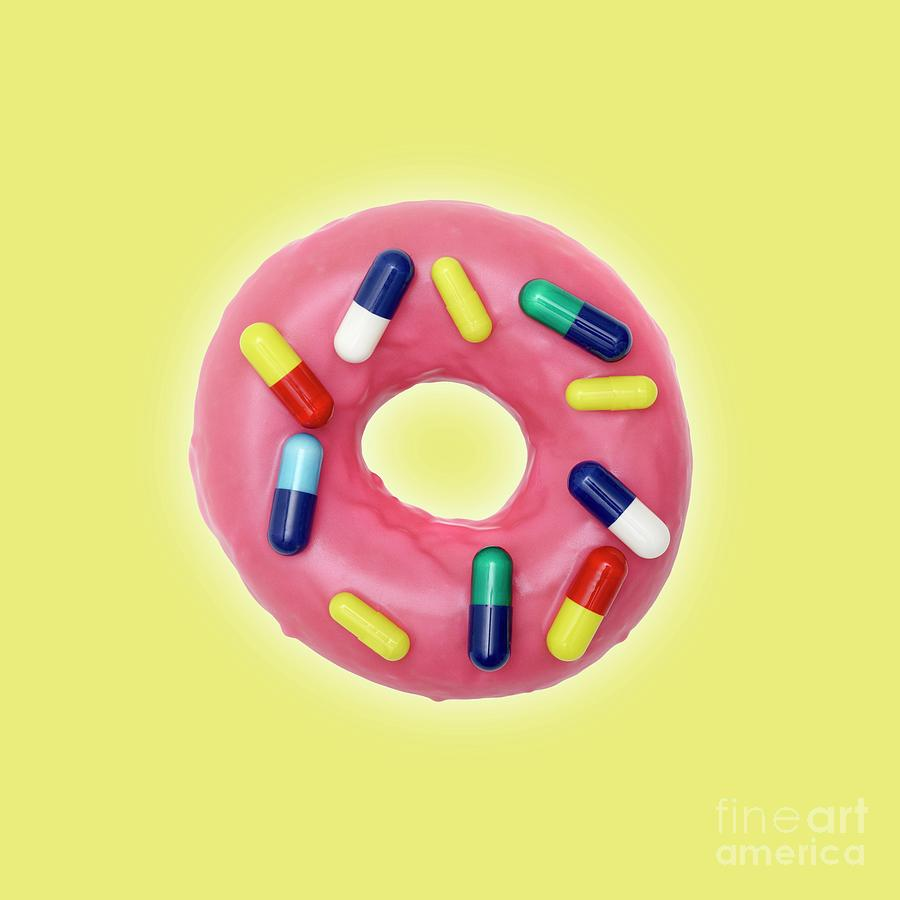 Close Up Photograph - Pink Doughnut With Capsules by Science Photo Library
