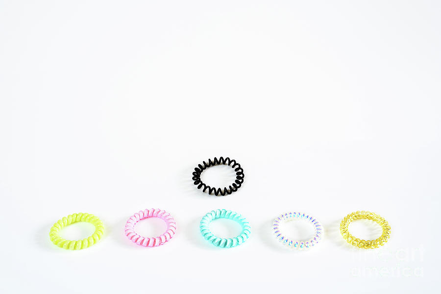 Plastic bracelets of various colors, isolated in a pattern arran by Joaquin Corbalan