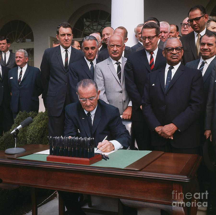 President Johnson Signing Civil Rights Photograph by Bettmann
