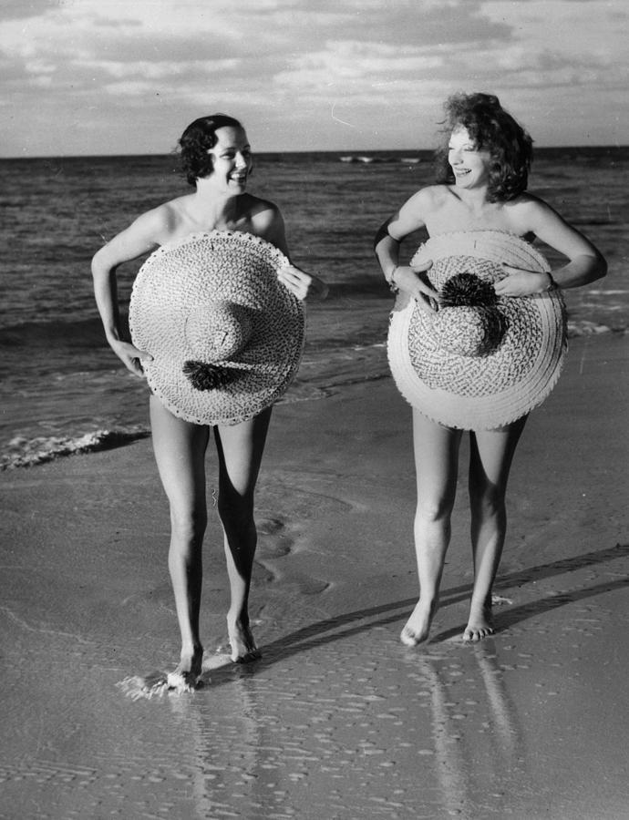 Protective Sunhats Photograph by Fox Photos