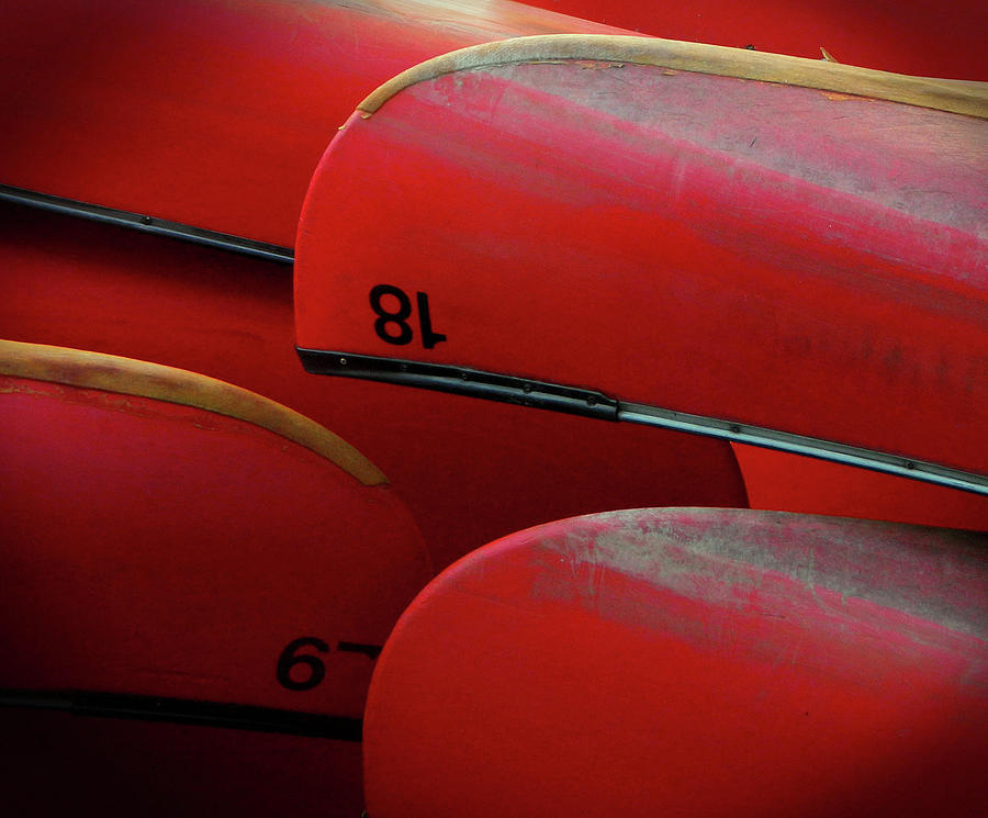 Red Canoes Photograph by Anne Mcdonald