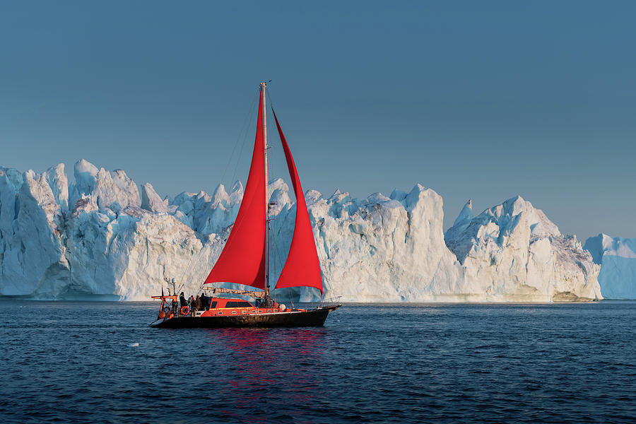 Red sail and Icebergs in Greenland by Suranga Weeratunga